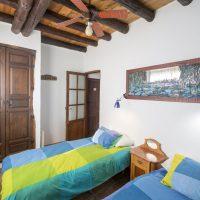 El Brazal. Dormitorio azul Nogal